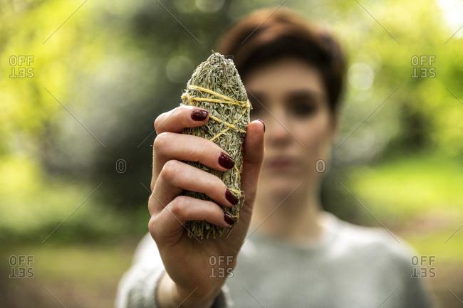 Woman holding healing stone for Reiki