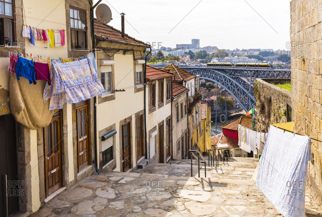 June 6, 2019: Washing lines in front of building, Ponte Dom Lu�s I in background, Porto, Portugal