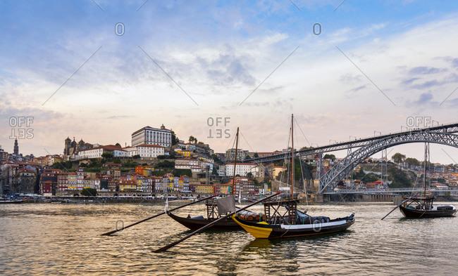 June 6, 2019: Traditional Portuguese wooden cargo boats transporting port wine on Douro River, Porto, Portugal