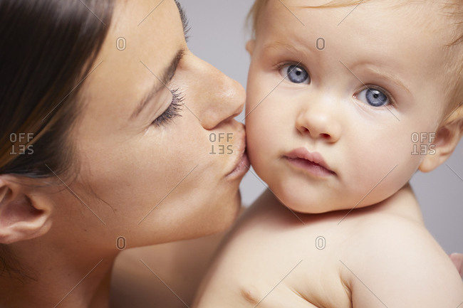 Mother kissing baby on cheek