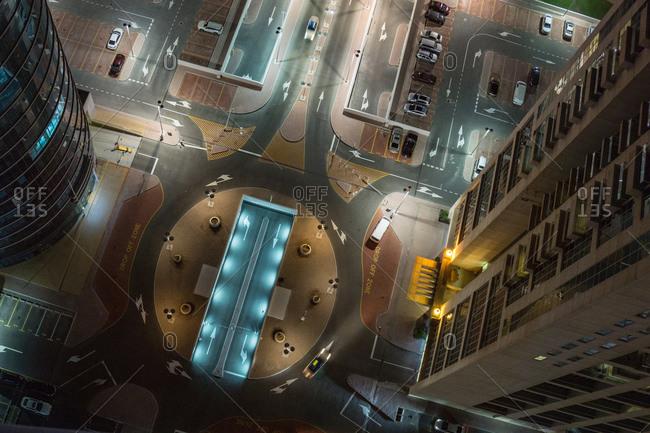 Overhead view, night scene, carpark below office buildings, Dubai, UAE