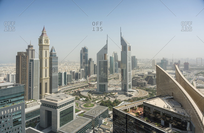 November 2, 2019: Dubai Clock Tower and Jumeirah Emirates Towers, Dubai, UAE