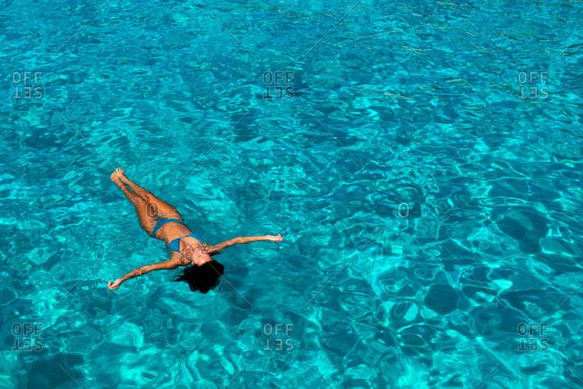 Woman in bikini enjoying clear sea water