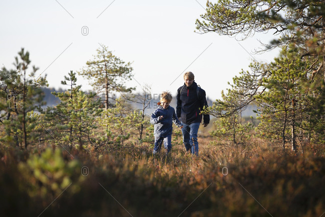 Father and son exploring forest, Finland