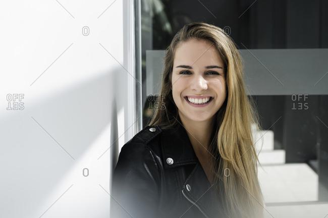 Female student taking break at corridor in campus