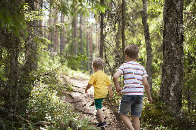 Brothers exploring forest in Finland