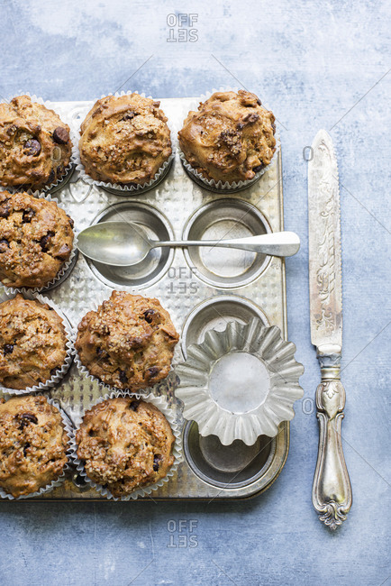 Freshly baked chocolate chip muffins on baking pan