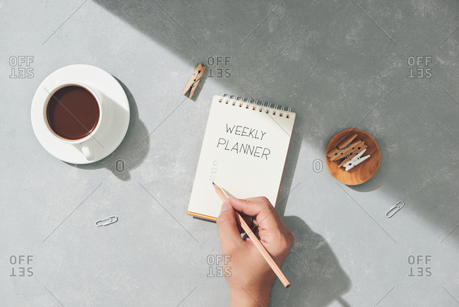 Flat lay desk with handwriting weekly planned