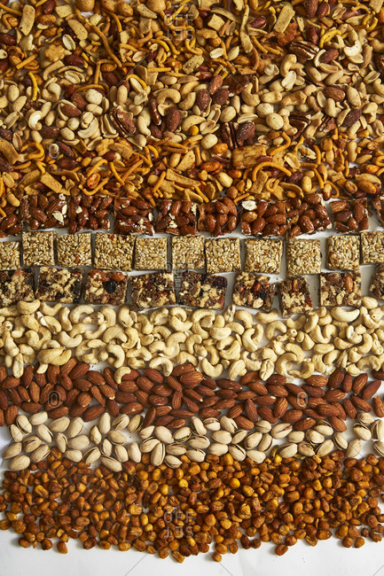 Overhead view of a variety of nuts and nut bars