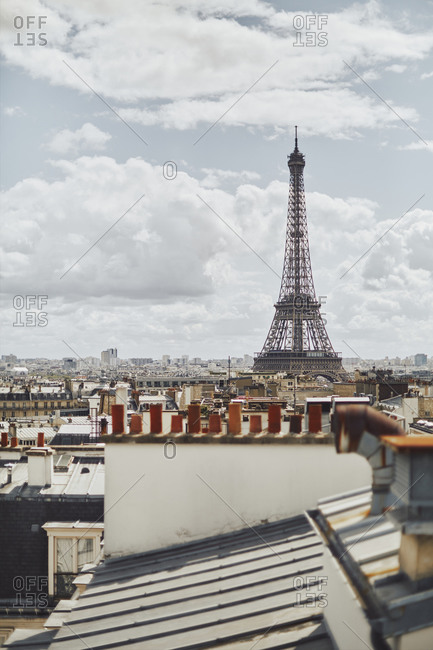 Paris, France - August 19, 2017: Eiffel Tower seen from a Paris rooftop