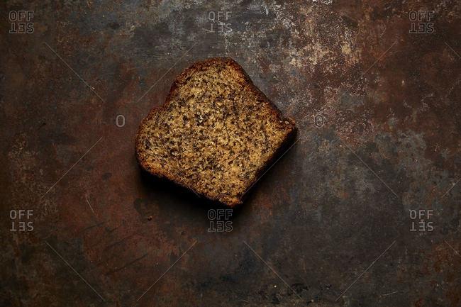 Slice of banana bread on dark background