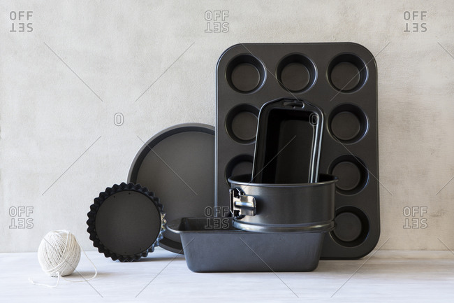 Various sizes of bakeware arranged on kitchen counter