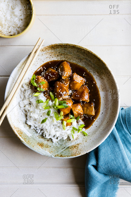 Orange Sesame Chicken with Rice in a bowl