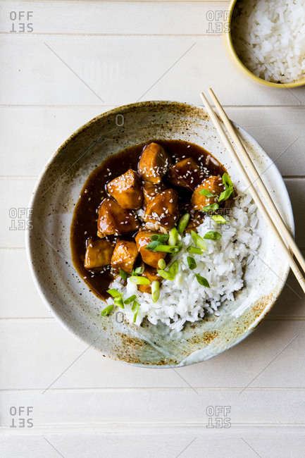 Overhead view of Orange Sesame Chicken with Rice in a bowl