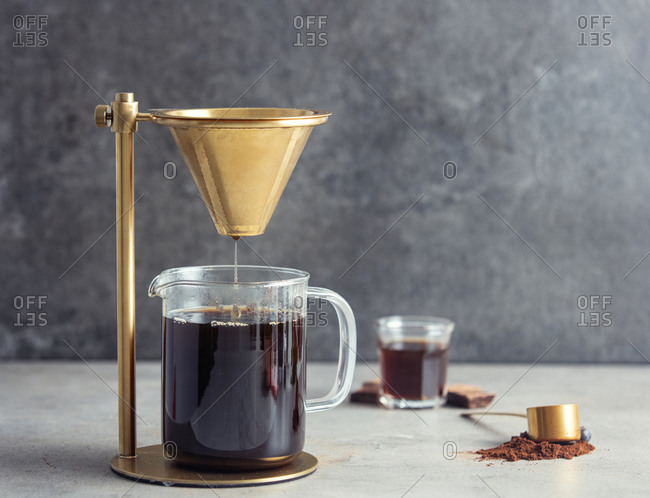 coffee is brewed and drained into a Cup