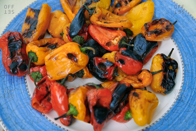 Freshly cooked juicy grilled peppers on a plate. BBQ themes