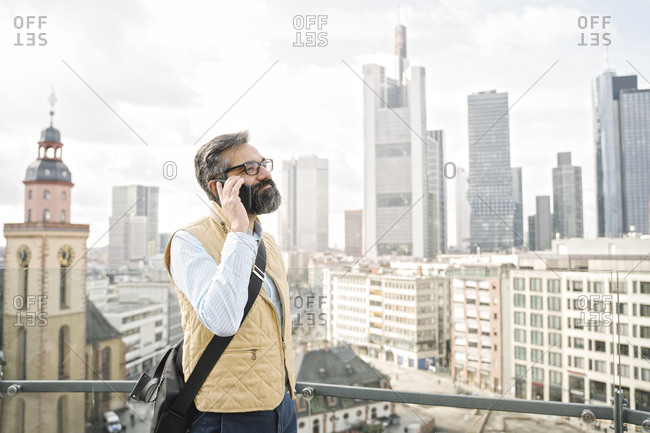 Man on the phone in front of skyscrapers- Frankfurt- Germany
