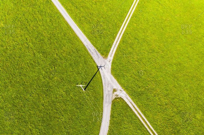Germany- Bavaria- Wessobrunn- Helicopter view of countryside crossroad in summer