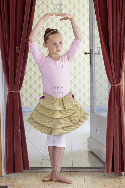 Girl playing with cardboard tutu