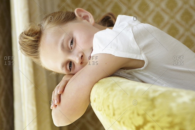 Portrait of a girl lying on a couch