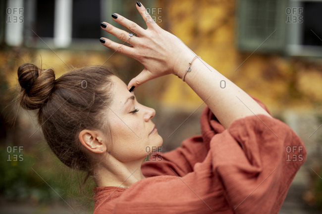 Portrait of woman practicing yoga outdoors