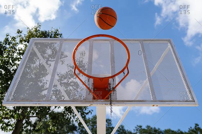 Basketball and hoop and sky