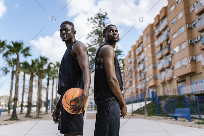 Young men with basketball on basketball court