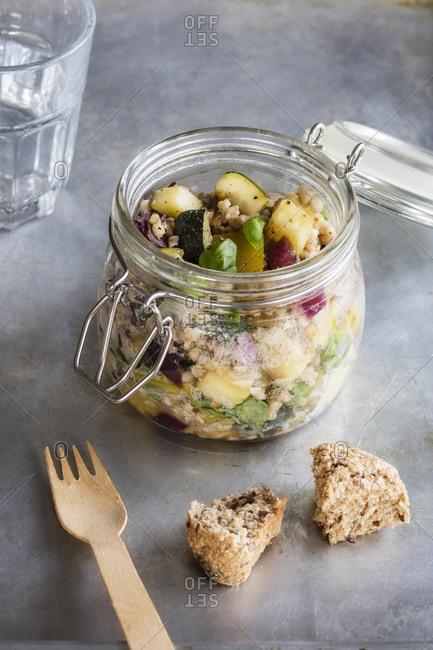 Jar of gluten free vegan salad withbuckwheat- zucchini and paprika