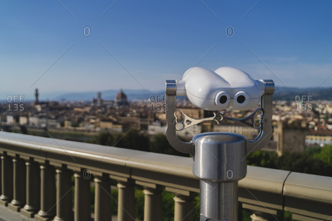 Italy- Tuscany- Florence- Close-up of coin-operated binoculars overlooking city