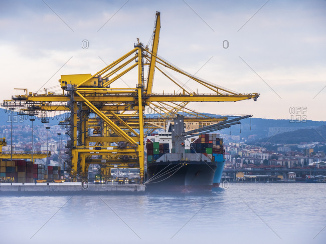 Italy- Province of Trieste- Trieste- Container ship docked in commercial harbor