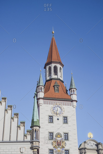 Germany- Bavaria- Munich- Low angle view of Old Town Hall clock tower standing against clear blue sky
