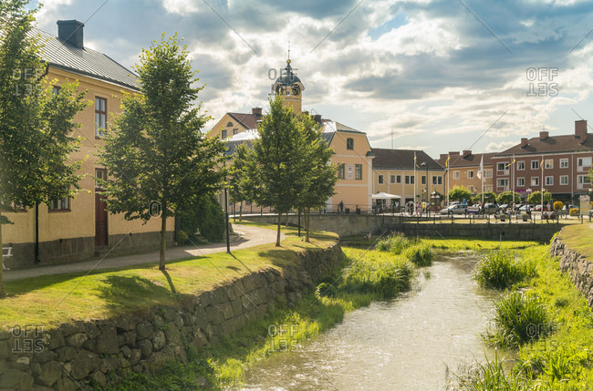 July 20, 2017: Sweden- Ostergotland- Soderkoping- Small city canal with town hall in background