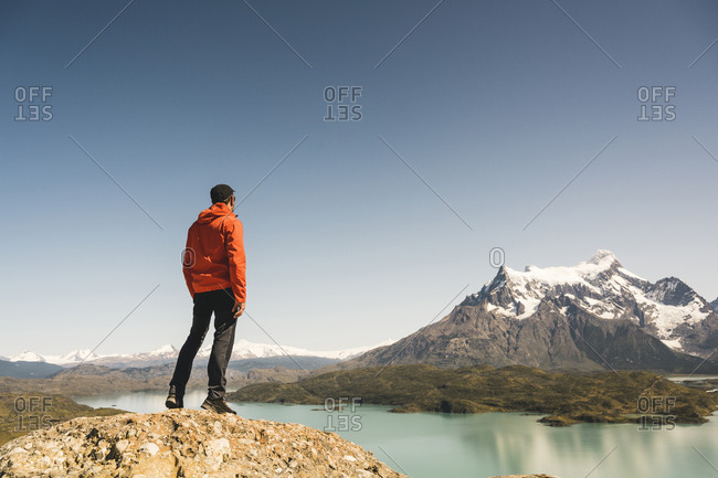 Hiker in mountainscape at Lago Pehoe in Torres del Paine National Park- Patagonia- Chile