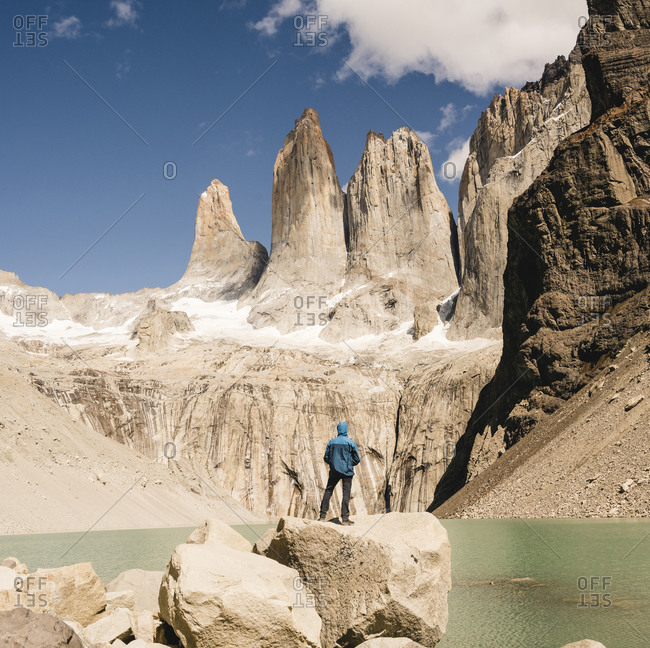 Hiker in mountainscape at lakeside at Mirador Las Torres in Torres del Paine National Park- Patagonia- Chile