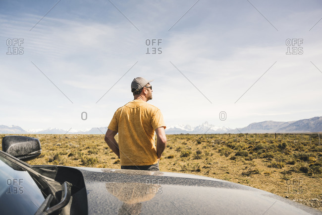 Rear view of man at car in remote landscape in Patagonia- Argentina