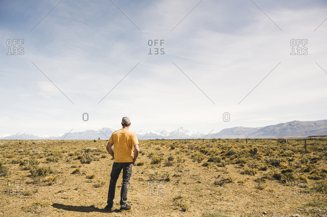 Rear view of man standing in remote landscape in Patagonia- Argentina