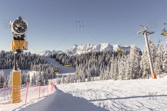 Austria- Styria- Schladming- Snow machine and ski lift at Planai ski slope