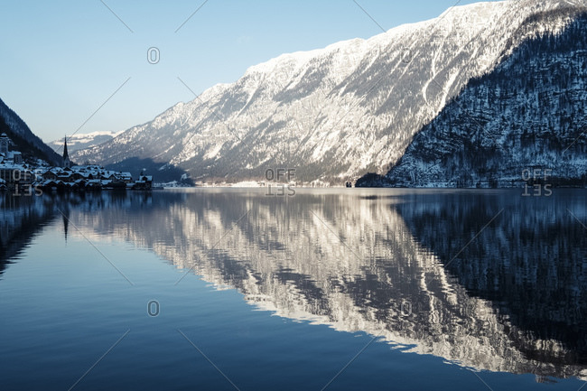 Austria- Upper Austria- Hallstatt- Mountains reflecting in shiny Lake Hallstatt