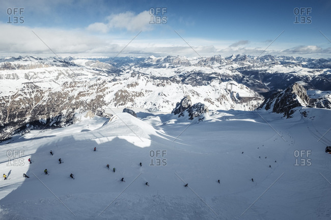 Italy- Trentino- Skiers seen from summit of Marmolada mountain