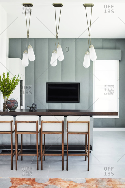 Paradise Valley, Arizona - July 10, 2019: Modern pendant lights hanging over kitchen island