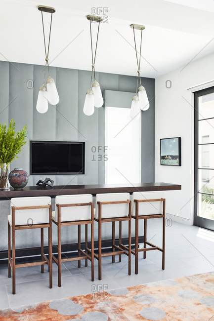 Paradise Valley, Arizona - July 10, 2019: Modern pendant lights hanging over kitchen island in an upscale home