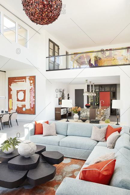 Paradise Valley, Arizona - July 10, 2019: Large two-story living room in a modern home with orange accents