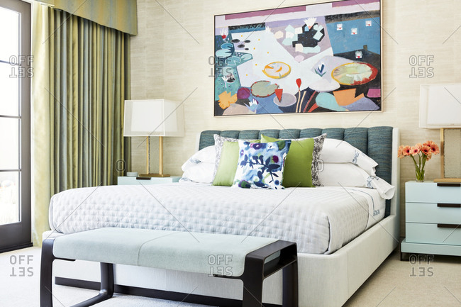 Paradise Valley, Arizona - July 11, 2019: Bedroom in a modern home with colorful artwork over bed