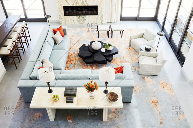 Paradise Valley, Arizona - July 10, 2019: View from open second-story of living room in a modern home with blue sectional sofa