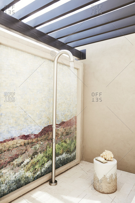 Paradise Valley, Arizona - July 11, 2019: Outdoor shower with mosaic western tile wall