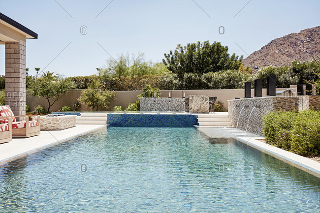 Paradise Valley, Arizona - July 9, 2019: Backyard with a luxurious blue tile pool