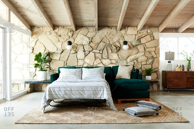 June 1, 2020: Living room interior with stone accent wall and a pullout sofa