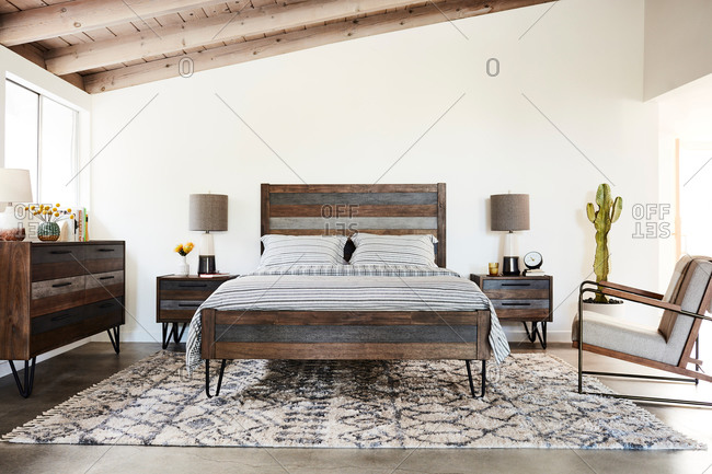June 1, 2020: Bedroom interior with rustic blue and wood midcentury modern furniture