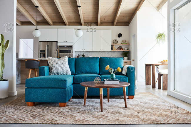 February 5, 2020: Blue sofa with chase in a modern home