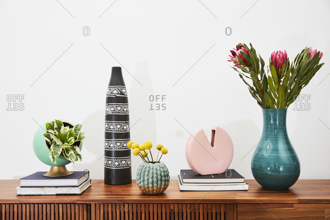 April 1, 2020: Books, flowers and decorative items on a wooden side table